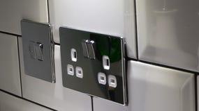 Power socket. Chrome power socket in the kitchen royalty free stock photos