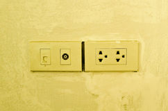Aerial and network outlet on wall. Stock Image