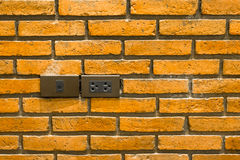 Power socket and lan socket on brick wall Stock Images