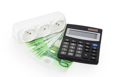 Power socket money and a calculator Stock Image