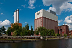 Power station. With three chimneys an at a canal Stock Image