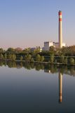 Power station. Picture of a power station - its mirror image in a river can be seen Royalty Free Stock Photo