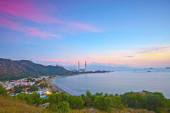 Power station along the seashore at sunset time Stock Images