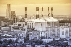Power station on the city district background. Royalty Free Stock Image
