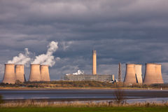 Power Station Cooling Towers - Greenhouse Gases. The cooling towers of a power station burning coal and biofuels on the the estuary of the River Mersey. Cheshire Stock Images