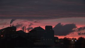 Evening at power station smoke billowing out. Power station in the evening as smoke goes into the sky stock video footage