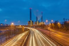 Power station and highway at night. Seen in Berlin, Germany Stock Photography