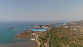 Power Station java, indonesia. Power station by sea with smoking pipes, paiton java, indonesia. aerial view power plant in asia stock video