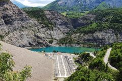 Power station and Lake Serre-Poncon, Hautes-Alpes, France. Lac de Serre-Poncon is a lake in southeast France and one of the largest artificial lakes in western stock photo