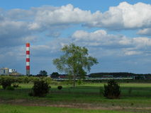 Power station, meadow, train and blue sky with nic Royalty Free Stock Images