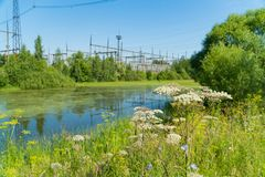 Power station near the pond. Power lines. Stock Photo