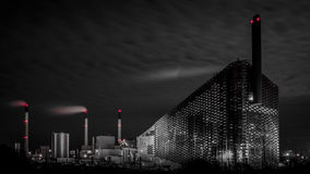 Power station at night. Power plant at night with smokestacks Royalty Free Stock Images
