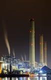 Power station at night with smoke Stock Photo