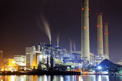 Power station at night with smoke Royalty Free Stock Images
