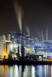 Power station at night with smoke Royalty Free Stock Photos