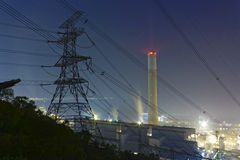 Power station at night with smoke Royalty Free Stock Photography