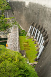 The power station at the Phumibol Dam in Thailand. On the Khwae Yai river in tak Province. Rockfill dam with nature in asia for background Stock Photos