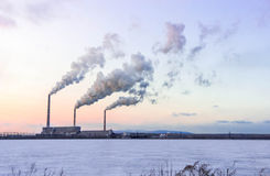 Power station pipes. Air pollution by a smoke from power station pipes Stock Image