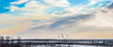 Power station pipes. Air pollution by a smoke from power station pipes Royalty Free Stock Images