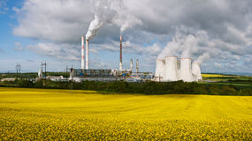 Power station with rape field Royalty Free Stock Images