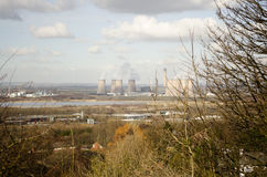Power Station by River. A scenic view of a power station by a river stock photos