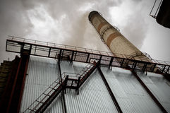 Power station with smoke stack Royalty Free Stock Photo