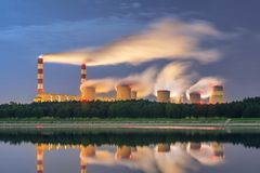 Power station, spinning pathways at night with smoke from chimneys Royalty Free Stock Photo