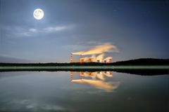 Power station, spinning pathways at night with smoke Stock Photography
