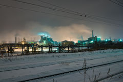 Power station with steam cloud blown by the wind. In a cold starry winter night Royalty Free Stock Photos