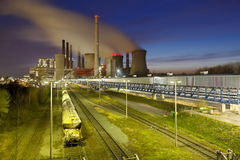 Power Station And Train At Night Royalty Free Stock Photography