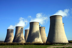 Power Stattion. Cooling towers of a coal-fired power station against blue sky Stock Image