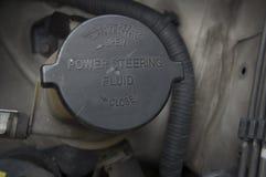 Power steering bottle fluid car automobile concept Stock Photo