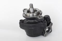 Power steering pump on a gray background Stock Images