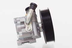 Power steering pump on a white background engine Royalty Free Stock Photo