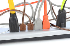 Power Strip With Electrical Cords. Closeup of an electrical power strip with several different cords plugged in royalty free stock photo