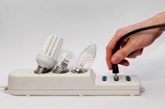Power strip with light bulbs and plug Stock Photos