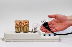 Power strip with money and plug Stock Photo