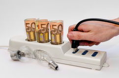 Power strip with money and plug stock images