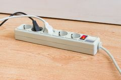 Power strip with two connected power plugs with corresponding ca. Power strip with electrical sockets of CEE 7 standard, illuminated power circuit breaker and royalty free stock photography