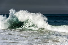 Green wave. Strong wave with dar sky at backgroung Stock Photos