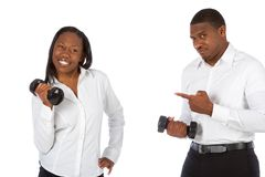 Power struggle #1. African-American couple competes in dumbbell lifting Stock Photography