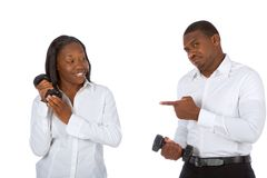 Power struggle #2. African-American couple competes in dumbbell lifting Stock Images