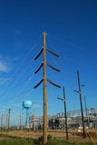 Power substation. Electrical power substation with new pole and water tower in background. South Padre Island, Texas Stock Photos