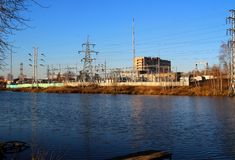 Power substation on the riverbank. Royalty Free Stock Photo