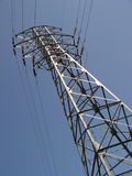 Power Superhighway. A steel tower supports electrical wires against a clear blue sky Royalty Free Stock Photo