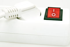 Power supply. Isolated power outlet with red button Stock Image