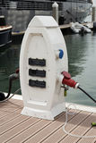 Power supply for boat charging. Power supply for electric bot charging. Electric boat charging station on the yacht club / Close up of the power supply plugged royalty free stock photos