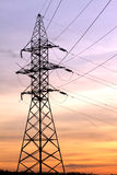 Power supply line metal tower on beautiful sunset Royalty Free Stock Photography
