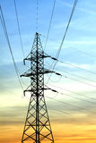 Power supply line tower on beautiful sunset Stock Photos