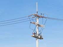 Power supply line with wires. Over  blue sky Royalty Free Stock Images